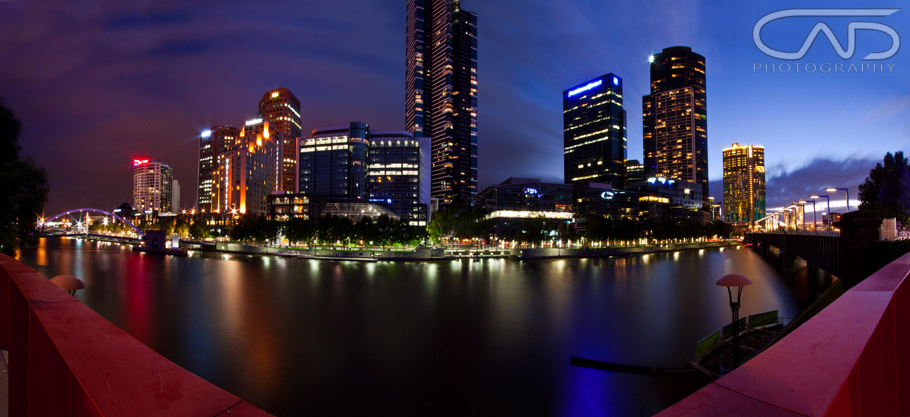 Wide angle photograph, at sunset at South Bank on the Yarra River looking at Eureka Tower and Crown Casino at Melbourne, Victoria, Australia