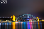 Sydney Harbour Bridge on a stormy cloudy night with some great water and cloud reflections!